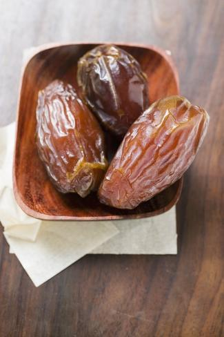 Three Dried Dates in Wooden Bowl Photographic Print