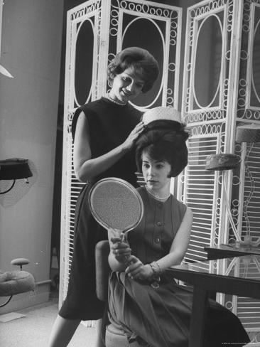 Jackie Kennedy Style Pillbox Hats Being Tried on by Models at Charles A. Stevens and Co Photographic Print