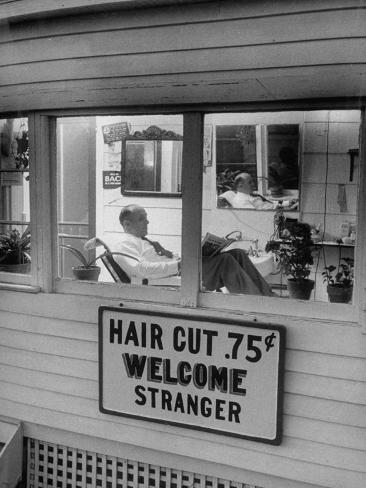 Man Waiting in a Barber Shop For a Haircut Photographic Print