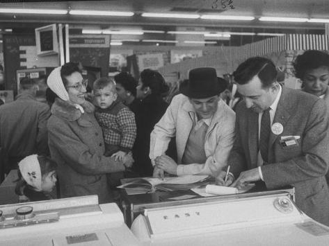 Shoppers Looking at Appliances in Polk's Department Store Photographic Print