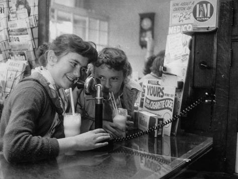 Teenage Girls Drinking Milkshakes at a Local Restaurant Photographic Print