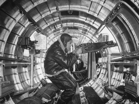 Crewman Poking His 50 Cal. Machine Gun Out of Side Window of B-17E Flying Fortress During WWII Photographic Print