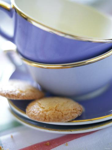 Empty Coffee Cups and Two Biscuits Photographic Print