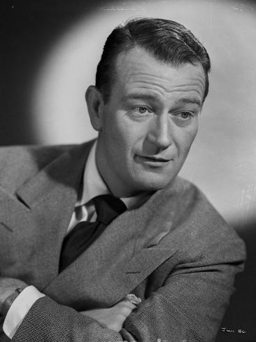 John Wayne wearing Suit and Crossing His Arms Photo