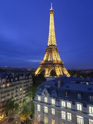 France, Paris, Eiffel Tower, Viewed over Rooftops at Night Photographic Print