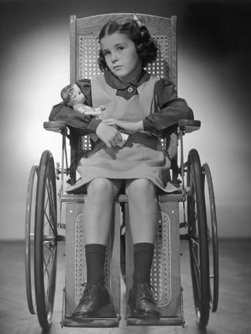 Young Girl in Her Wheelchair W/Her Doll Photographic Print