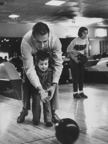 Dad Showing 3 Year Old Daughter the Basics of Bowling Photographic Print