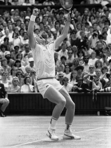 German Wonder Boy Boris Becker Raises Arms in Triumph After Winning the Wimbledon Crown Photographic Print