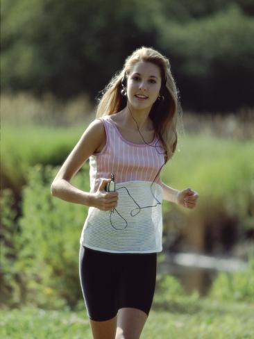 Girl Jogging with Headphones Photographic Print