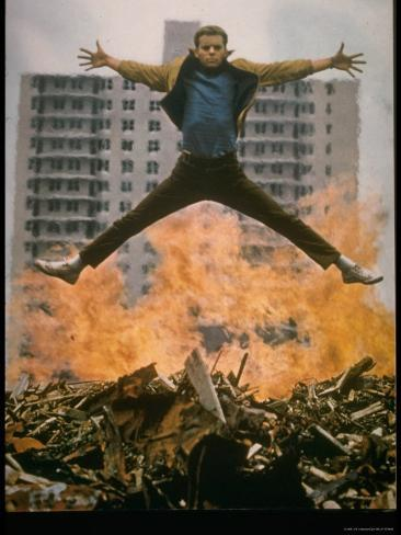 Riff Leaps over Smoldering Rubble of New York Slum Clearance Project in Scene from West Side Story Exklusivt fotoprint