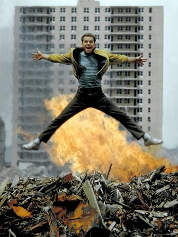 Riff Leaps over Smoldering Rubble of New York Slum Clearance Project in Scene from West Side Story Premium Photographic Print