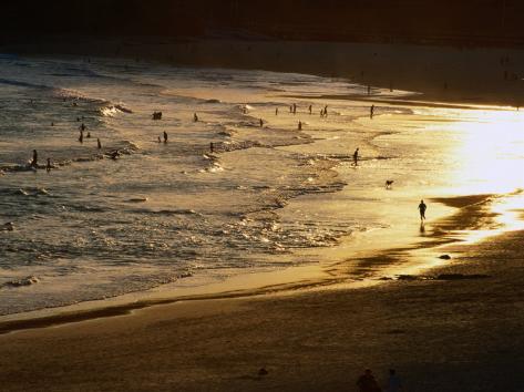 The Setting Sun Illuminates Surfers and Swimmers on Bondi Beach, Sydney, Australia Photographic Print