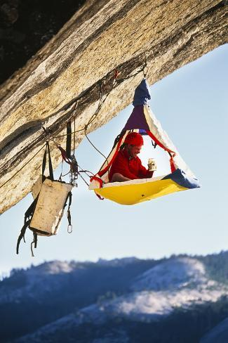 Rock Climber Bivouacked in His Portaledge on an Overhanging Cliff. Photographic Print