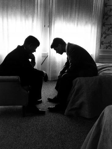 Jack Kennedy Conferring with His Brother and Campaign Organizer Bobby Kennedy in Hotel Suite Photographic Print