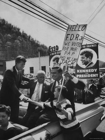 John F. Kennedy and Franklin D. Roosevelt Jr. Shaking Hands with Boy During Parade Photographic Print