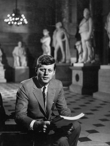 Senator John F. Kennedy Seated in Museum with Statues Photographic Print