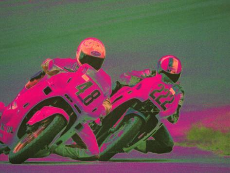 Two People Racing Motorcycles Photographic Print