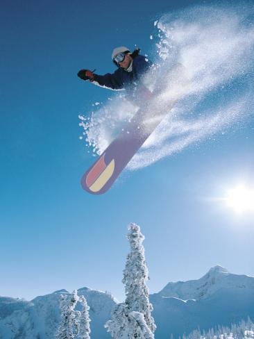 Man snowboarding on sunnny day Photographic Print
