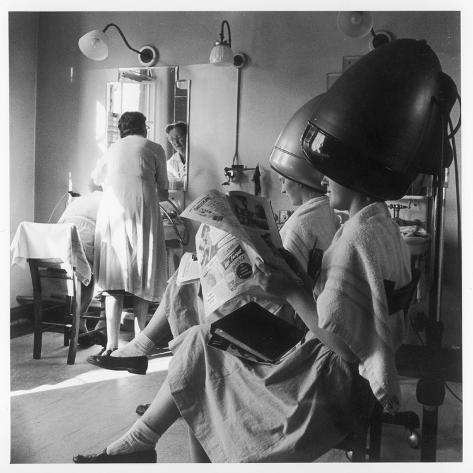 Women Sitting under Hair Dryers at the Hairdressers Photographic Print