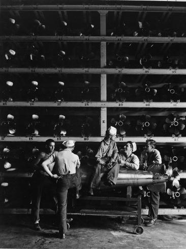Torpedo Men Relaxing Beneath Rows of Deadly Torpedoes in Torpedo Shop During WWII Photographic Print