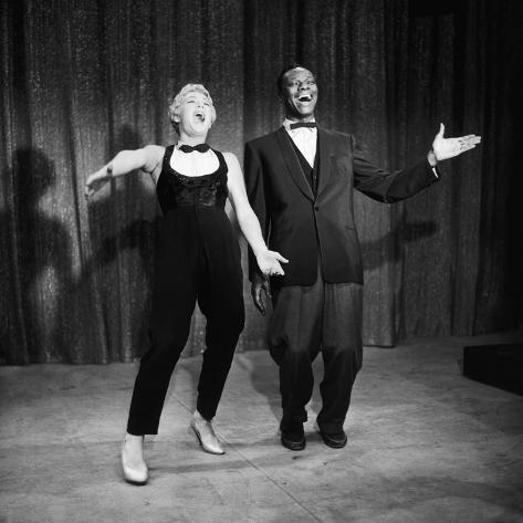 Nat King Cole and His Guest Star Betty Hutton Belt Out a Tune,