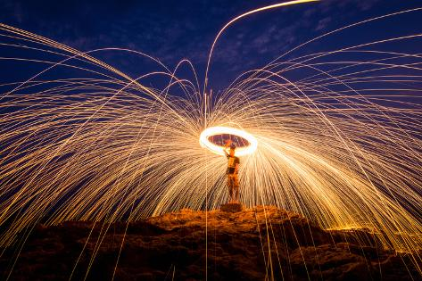 Fire Dancing on the Rocks Photographic Print
