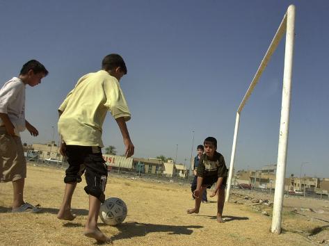 Iraqi Boys Play Soccer in a Baghdad Neighborhood Photographic Print