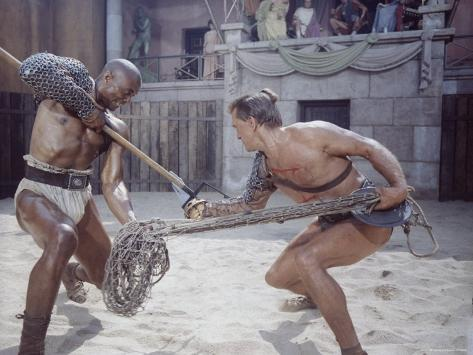 Actor Woody Strode Squaring Off Against Actor Kirk Douglas in Gladiator Battle in