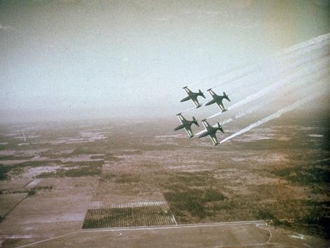 US Navy Stunt Pilots of the Blue Angels Flying their F9F Jets During an Air Show Photographic Print