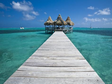 Belize, Ambergris Caye, San Pedro, Ramons Village Resort Pier and Palapa Photographic Print
