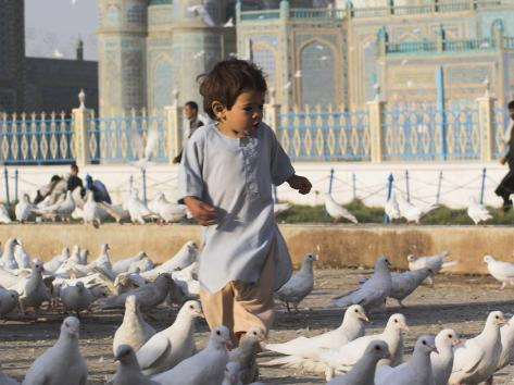 Child Chasing the Famous White Pigeons, Mazar-I-Sharif, Afghanistan Photographic Print