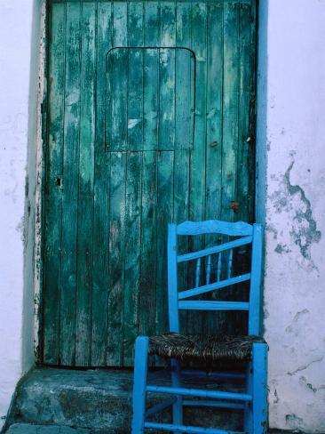 Chair in Front of a Green Door in the Village of Caceres, Caceres, Extremadura, Spain Photographic Print