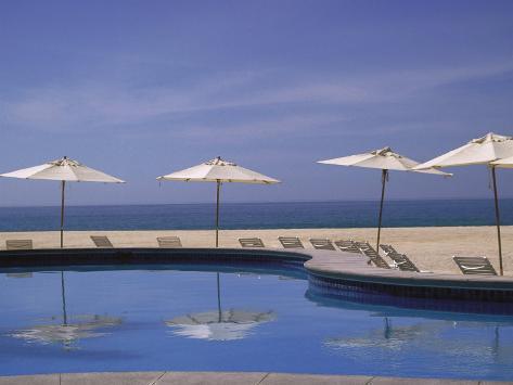 Pool and Umbrella, Cabo San Lucas, Mexico Photographic Print