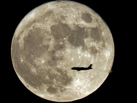 Jet is Silhouetted on the Full Moon in St. Petersburg, Russia Photographic Print