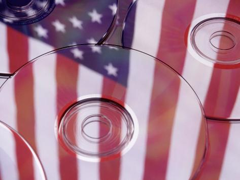 Cds with Reflection of American Flag Photographic Print