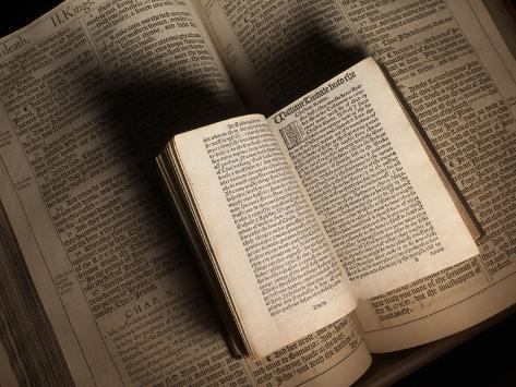 William Tyndale's New Testament Sits on a King James Bible from 1611 Photographic Print
