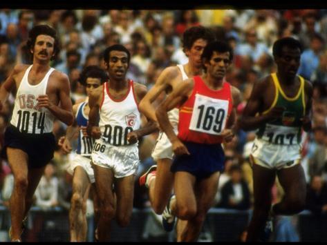us track athlete frank shorter running a marathon at the. Black Bedroom Furniture Sets. Home Design Ideas