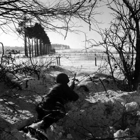 American Soldier Peering Across Snowy Field During Counter Offensive Known as Battle of the Bulge Photographic Print