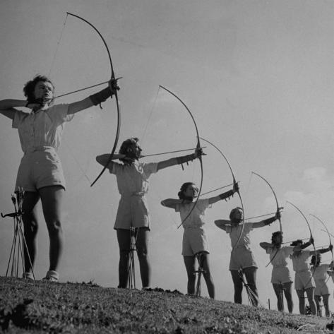 Girls Practicing Archery Photographic Print