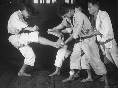 Japanese Karate Student Breaking Boards with Kick Photographic Print