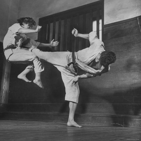 Law Student Gojuro Harada Uses Right Foot on the stomach to ward off attack of economics student Photographic Print