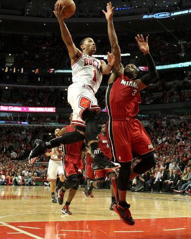 Miami Heat v Chicago Bulls - Game Five, Chicago, IL - MAY 26: Derrick Rose and Dwyane Wade Photo
