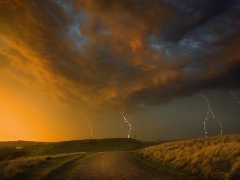 Thunderstorm and Orange Clouds at Sunset Photographic Print