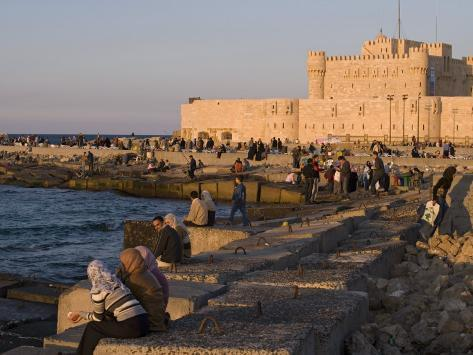 Friends and Couples Gather at Sunset Outside the Citadel of Quatbai, Alexandria, Egypt Photographic Print