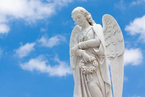 Beautiful White Angel with a Blue Sky Background (With Space for Text) Photographic Print