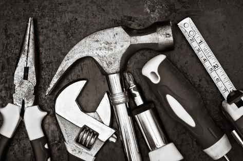 Black and White Image of a Set of Tools on a Textured Metallic Background Photographic Print