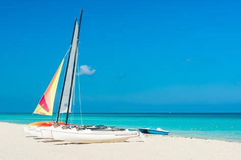 Colorful Sailing Boats for Rent on a Sunny Day at Varadero Beach in Cuba Photographic Print