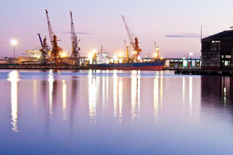 Commercial Docks at Sunset with a Ship and Cranes Photographic Print