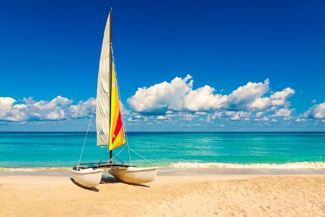Sailing Boat on a Beautiful Summer Day at Beach in Cuba Photographic Print