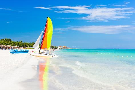 Scene with Sailing Boat at the Famous Varadero Beach , Caribbean Sea in Cuba Photographic Print